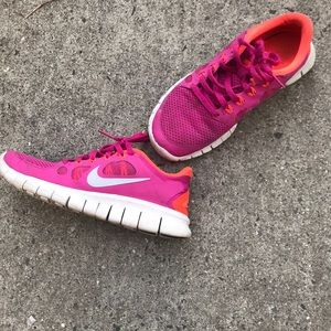 Pink and orange Nike sneakers